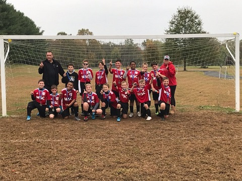 Congrats to the U12B Wilson team!  These boys played in the JIL (Joint Intramural League) and went undefeated and were crown Champions of their bracket!  Way to go Boys and great work Coaches!